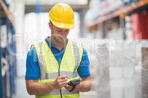 Worker using hand held computer
