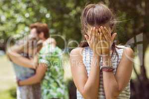 Brunette upset at seeing boyfriend with other girl