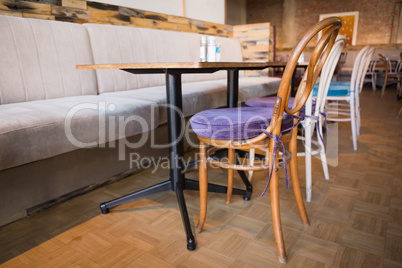 Stylish coffee shop with tables and chairs