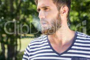 Hipster smoking electronic cigarette