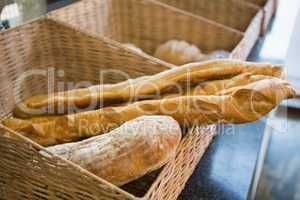 Basket with fresh breads and baguettes
