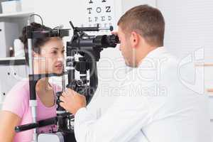 Female patient being examined by optician in clinic