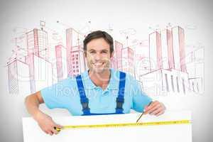 Composite image of happy carpenter measuring blank bill board