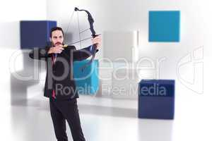Composite image of focused businessman shooting a bow and arrow