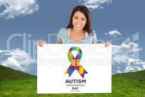 Composite image of beautiful woman holding a  board