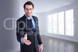 Composite image of hand being offered by smiling businessman