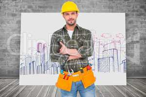Composite image of manual worker with tool belt