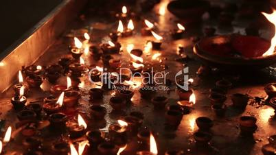 Burning candles in the Indian temple. Diwali – the festival of lights.
