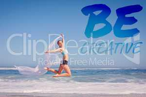 Composite image of fit woman jumping gracefully on the beach wit