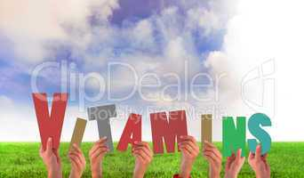 Composite image of hands holding up vitamins