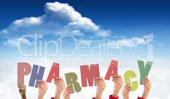 Composite image of hands holding up pharmacy