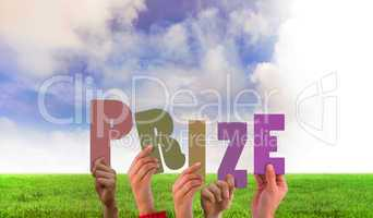 Composite image of hands holding up prize
