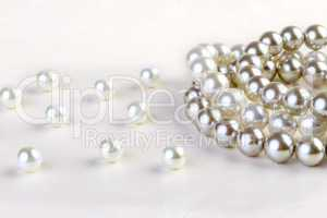 Silver and White pearls necklace on white paper