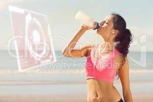 Composite image of beautiful healthy woman drinking water on bea