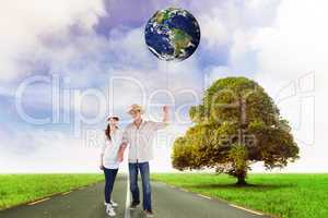 Composite image of smiling couple both wearing hats