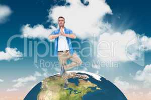 Composite image of man with grey hair in tree pose