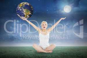 Composite image of toned young woman sitting with arms outstretc