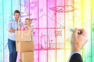 Composite image of attractive young couple leaning on boxes with