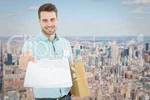 Composite image of delivery man with package giving clipboard fo