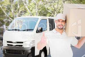 Composite image of delivery man with cardboard box gesturing thu