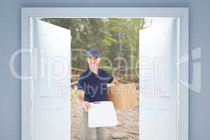 Composite image of happy delivery man holding cardboard box and