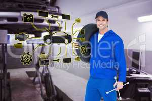 Composite image of confident mechanic carrying tire