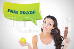 Composite image of pretty brunette deciding between apple and ch