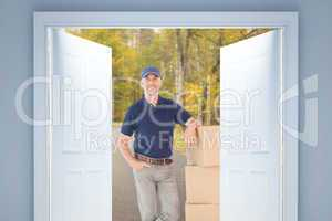 Composite image of happy delivery man leaning on pile of cardboa