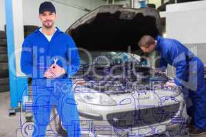 Composite image of smiling male mechanic holding spanner