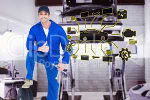 Composite image of mechanic with tire and wheel wrenches gesturi