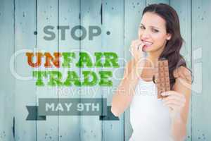 Composite image of pretty brunette fearfully looking at chocolat