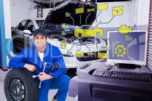 Composite image of mechanic leaning on tire while holding wheel