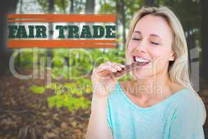 Composite image of pretty blonde enjoying and eating bar of choc