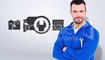Composite image of happy mechanic holding spanner on white backg