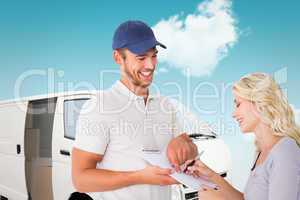 Composite image of happy delivery man getting signature from cus