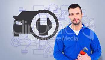 Composite image of smiling male mechanic holding monkey wrench