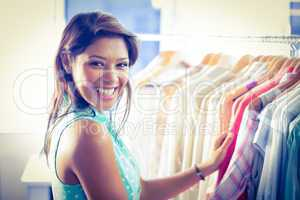 Happy shopper smiling at camera