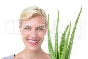 Attractive woman holding aloe vera plant