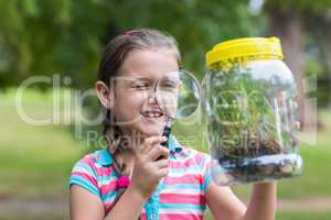 Curious little girl looking at jar