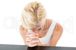 Pretty blonde woman praying