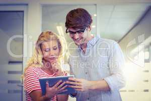 Colleagues looking at tablet pc together