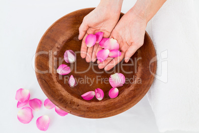 Petals of flower in wooden bowl