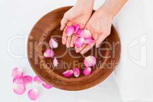 Petals of flower in wooden bowl