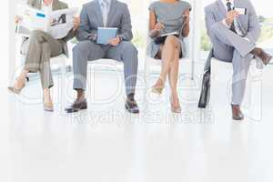 Business people sitting and waiting