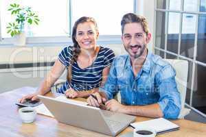 Partners smiling at camera