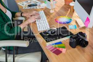 Designer typing on keyboard