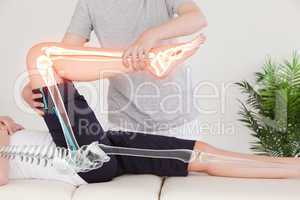 Highlighted bones of woman at physiotherapist