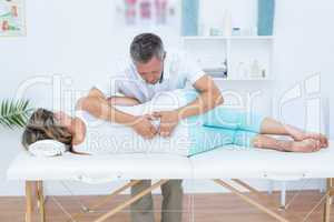 Doctor massaging his patient back