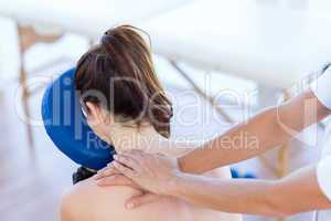 Woman having back massage