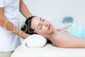 Physiotherapist doing neck massage